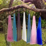 Fused Glass and drift wood wind chime by Janice Bradshaw in pinks and blues